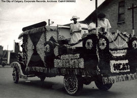 """Cook Electrically"" float in the Stampede Parade at 9th Avenue and 5th Street SW, Calga..."